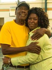 Victor Hart Sr. hugs Theresa Baxter, who coordinates