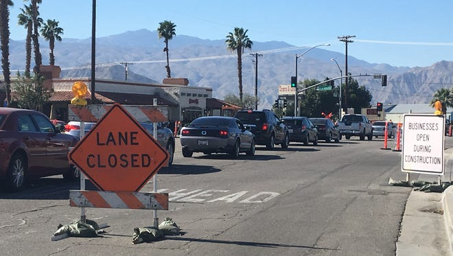 Traffic backs up on Highway 111 in Indio where a widening project is taking place. Work will continue during the Riverside County Fair and National Date Festival.