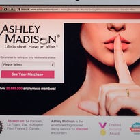 This photo illustration shows the homepage of the Ashley Madison dating website displayed on a laptop in Hong Kong.