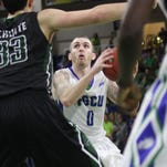 USC Upstate's Ty Greene is defended by FGCU's Marc-Eddy Noreliaand Julian DeBose during the A-Sun tournament semifinal on Thursday night.