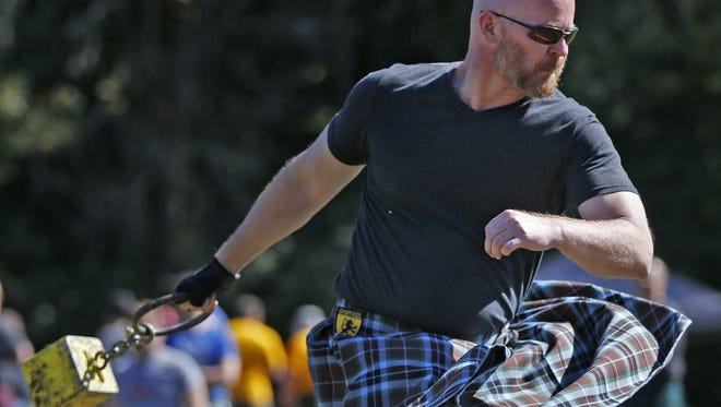 Lex Thompson competes in a weight throw competition during the Indianapolis Scottish Highland Games and Festival, on Saturday, Oct. 8, 2016, at German Park.