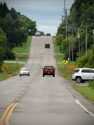 Traffic moves along 33rd Street South on Thursday, Aug. 17, in St. Cloud.