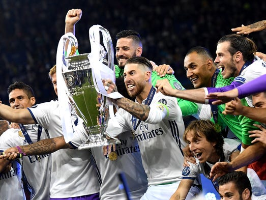 Real Madrid's Sergio Ramos lifts the trophy while celebrating