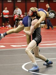 Noah Carpenter of Elmira lifts Pat Borelli of Chenango