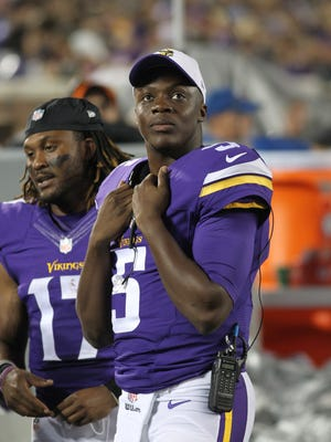 Minnesota Vikings quarterback Teddy Bridgewater watches from the sidelines during the second half of a preseason NFL football game against the Oakland Raiders, Saturday, Aug. 22, 2015, in Minneapolis. (AP Photo/Andy King)