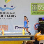 Guam weightlifter Kimberly Taguacta takes to the stage in her first attempt at a 57-kilogram snatch. She lifted a 62-kilogram snatch in her second attempt at the Sir John Guise Indoor Gymnasium to secure Guam's first individual medal at the 2015 Pacific Games at the Port Moresby, Papua New Guinea. Taguacta competed in the 53-kilogram senior divison.