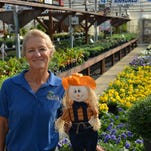 Valerie Cordrey with a friendly scarecrow.