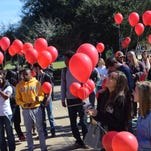 "LSU of Alexandria students, faculty and staff gather in the campus Quad Tuesday with red balloons. The LSUA Student Government held  the ""LSUA Release for Peace""  to honor those around the world affected by terror and natural disasters."