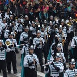 Gulf Coast High School band members march down 6th Avenue in New York City on Thursday in the Macy's Thanksgiving Day Parade.