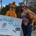 Birthright Israel representatives stand outside the Student Union wearing a camel costume and holding a stuffed camel on Feb. 2.  Birthright Israel is a non-profit organization that has students travel to Israel for 10 days.