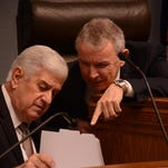 Senate President John Alario, left, and Revenue Estimating Conference Chairman James Richardson discuss revenue projections Thursday.