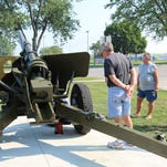 Iconic World War II cannon returns to Perry Street with new shine