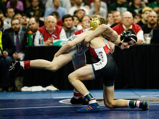 Ankeny Centennial's Ben Monroe wrestles Cullan Schriever of Mason City during their class 3A 106 pound championship match at the Iowa high school state wrestling tournament on Saturday, Feb. 18, 2017 in Des Moines.