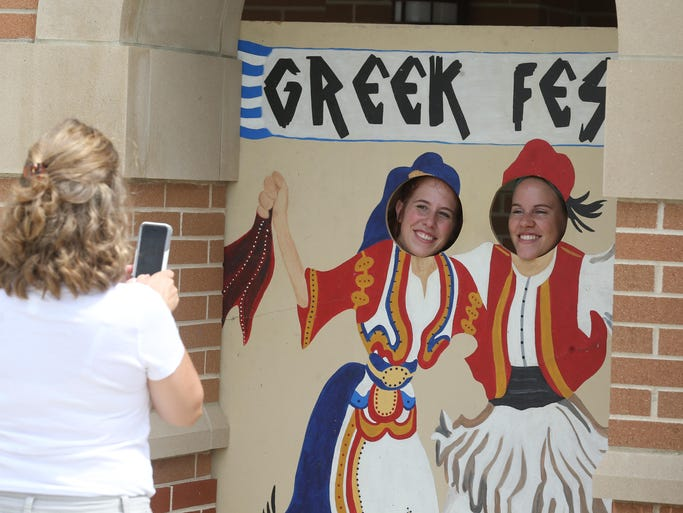 Tina McNulty, Carmel snaps a photo of her daughters Nicole McNulty, 20 and Rachel McNulty, 18. The Indianapolis Greek Fest at the Holy Trinity Greek Orthodox church was held over the weekend and here is the scene Sunday August 24, 2014.