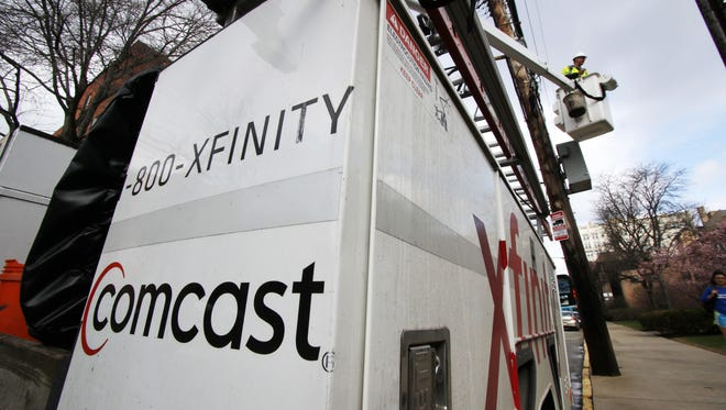File photo take in March 2017 shows a Comcast employee at work in Pittsburgh.