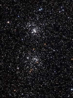 The Double Cluster in Perseus, photographed in 2014. NGC 869 is at top, and NGC 884 is below. [Photo by Genuson (Own work) [CC BY-SA 3 (https://creativecommons.org/licenses/by-sa/3)], via Wikimedia Commons]