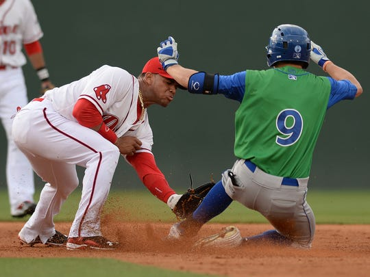 Brandon Downes (9), playing with the Lexington Legends in 2015, slides into second under the tag of Greenville Drive infielder Yoan Moncada.