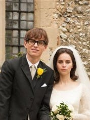"""This image released by Focus Features shows Eddie Redmayne as Stephen Hawking, left, and Felicity Jones as Jane Wilde in a scene from """"The Theory of Everything."""""""