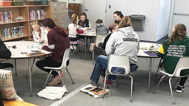 Pratt High School students work with elementary school kids through the Greenback Match mentoring program.