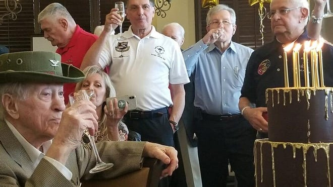 """Col. Howard """"Scrappy"""" Johnson (bottom left) celebrated his 100th birthday Sunday with a party at Abacoa Golf Club. Johnson, who lives in Palm Beach Gardens, trained pilots in World War II and flew fighter planes in Korea and Vietnam."""