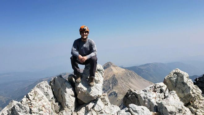Adam Klopp sits at the top of Capitol Peak on Aug. 21, 2020, the final 14er left on the hiker's list of the 58 in Colorado.