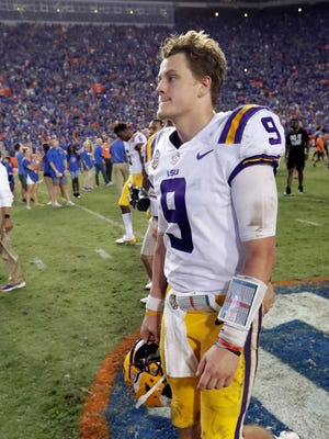 LSU quarterback Joe Burrow leaves the field after the team's 27-19 loss to Florida in an NCAA college football game Saturday, Oct. 6, 2018, in Gainesville, Fla. (AP Photo/John Raoux)