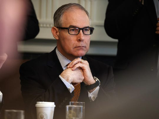 In this June 21, 2018, file photo, then-EPA administrator Scott Pruitt listens during a cabinet meeting at the White House. Pruitt, the scandal-ridden former head of the Environmental Protection Agency, registered as an energy lobbyist in Indiana on Thursday, April 18, 2019, as fossil-fuels interests there are fighting to block the proposed closure of several coal-fired power plants.