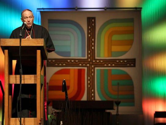 Catholic Bishop Richard Pates speaks to a large crowd