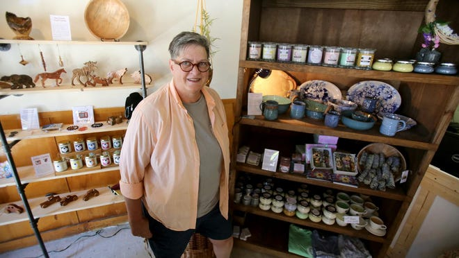 Lisa Lahti shows off the work of North Carolina artists at Uncommon Artisans in Kings Mountain.