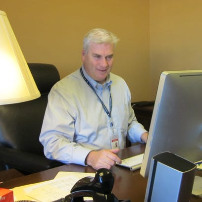 Rep.-elect Tom Emmer settles into his new Washington, D.C., office, including trying to log on to his computer for the first time Monday.
