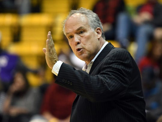 Southern Miss head coach Doc Sadler yells to his players