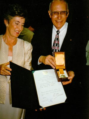 This photo shows Al and Mary Utton following the 1997 Mexico City ceremony in which he was presented with the Aztec Eagle Award, the highest honor Mexico bestows on a foreigner, for service to Mexico and to humanity.