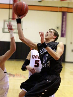 Piedra Vista's Keegan Acosta lays the ball up during a game against Aztec on Friday at Lillywhite Gym in Aztec.