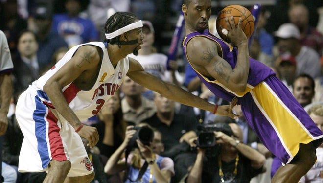 Pistons guard Richard Hamilton plays touch defense on Kobe Bryant during the second quarter in Game 3 of the NBA Finals on June 10, 2004, at the Palace of Auburn Hills.