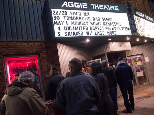 People wait to enter the Aggie Theatre on the second