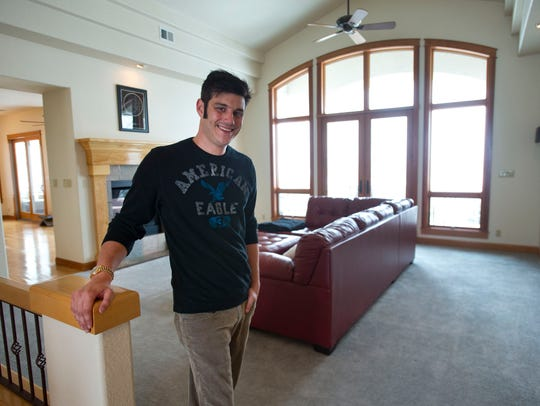Matt Bristow poses for a photo at his home in north
