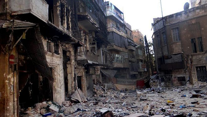 This Friday, Sept. 6, 2013 shows damaged residential buildings from heavy fighting between Free Syrian army fighters and government forces in Aleppo, Syria.