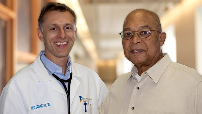Lynwood Battle (right) is appreciative of his heart failure team, led by Dr. Greg Egnaczyk, medical director of the Heart Failure Program at The Christ Hospital.