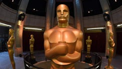 An Oscars statue stands at the end of the red carpet