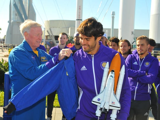 The Orlando City Soccer team was invited to watch the ULA Atlas V rocket launch today then take the VIP tour of Kennedy Space Center Visitor Complex, where they met up with veteran NASA astronaut Jon McBride. After being presented a team jersey, Jon McBride presents Kaka with a NASA jacket.