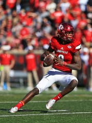Louisville's Lamar Jackson had three passing touchdowns for 355 yards and one rushing touchdown as the Cardinals rolled to 54-13 win over NC State Saturday, Oct. 22. He had six receptions for one touchdown and 118 yards.