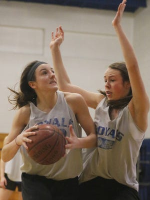 Mac Zurfluh, left, goes against Elle Leberg during basketball practice at Assumption High School in Wisconsin Rapids, Tuesday, March 8, 2016.