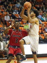 UTEP junior forward Paul Thomas, 1, drives to the basket