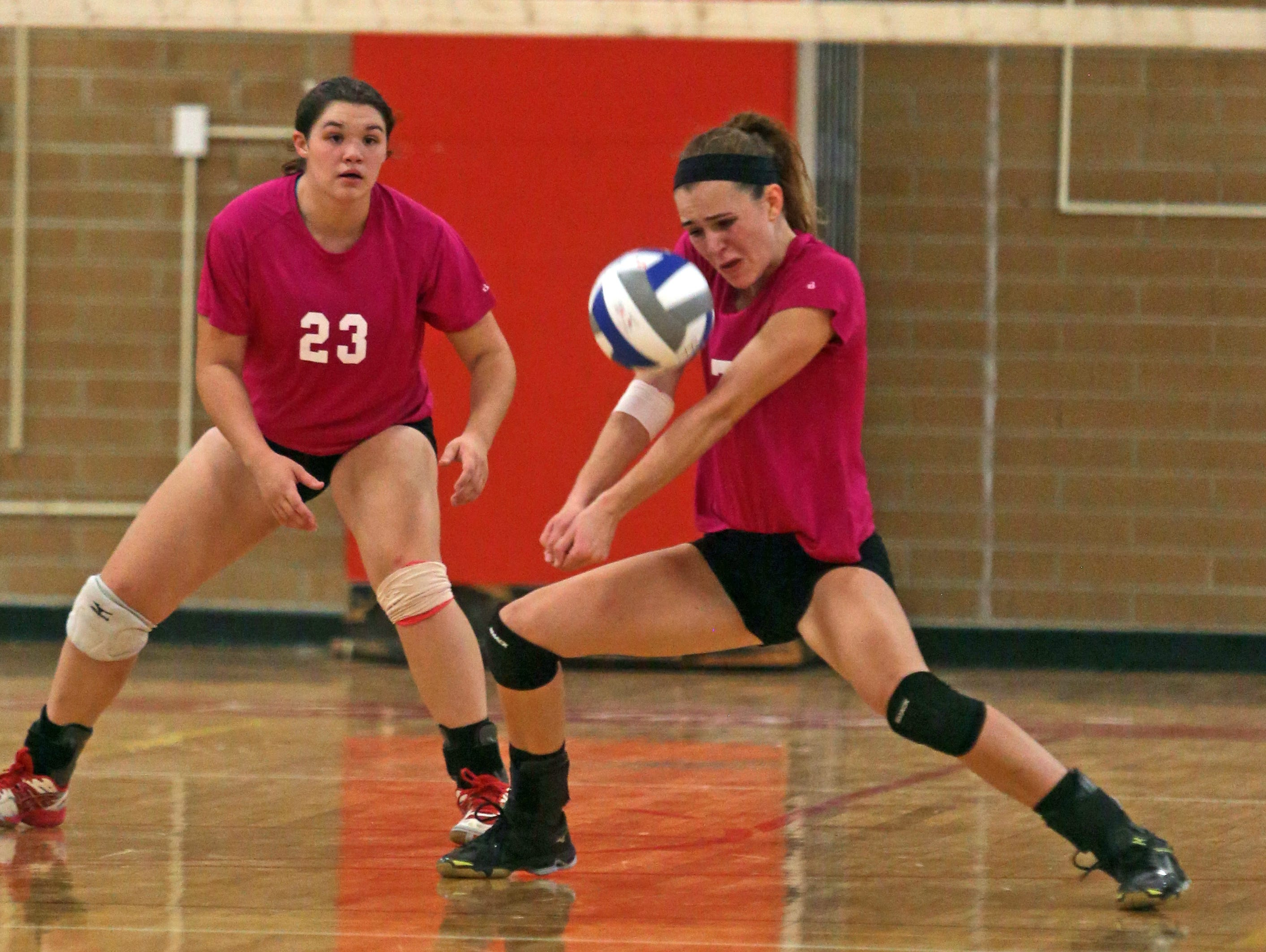Suffern's Kristen Conway, left, tries to block a shot by North Rockland's Shannon Thomas during a varsity volleyball match at North Rockland High School Oct. 7, 2015. Suffern defeated North Rockland in five games.