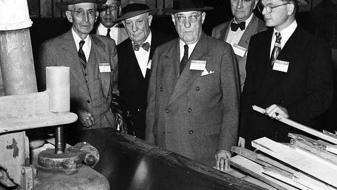 A visit to the E.L. Bruce Co. plant on North Thomas was part of the program during a four-day sales conference being held by the company in early April 1952. Showing a group through the plant were E.L. Bruce Jr. (Third from Right), president of the company and W.L. Wood (Second from Right), vice president in charge of sales.  Among the visitors wre (From Left) Robert Whitlock of El Paso; Robert A. White of Kingston, NY; L.O. Smith of Detroit and Robert Sconce of Omaha (Right).  The Commercial Appeal files.