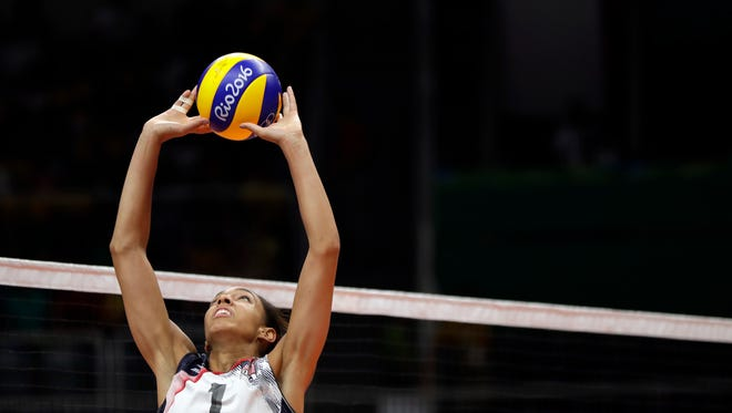 United States' Alisha Glass sets the ball during a women's preliminary volleyball match against Puerto Rico at the 2016 Summer Olympics in Rio de Janeiro, Brazil, Saturday. (AP Photo/Matt Rourke)