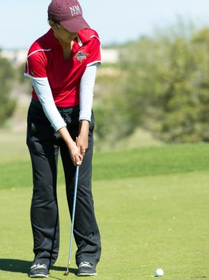 Centennial High School golfer Laura Benitez, 17, putts the ball at the 18th hole on Tuesday at New Mexico State University Golf Course.