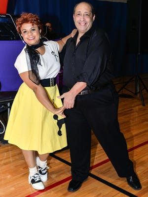 "Police Athletic League dancer Gusti Labatte-Deneau, left, and professional partner Eliott Acosta practice steps at a recent ""Get Down Motown"" party ahead of Oct. 7 Dancing With Our PALs competition at Sunrise Theatre. Tickets are available at FortPiercePAL.com/dancing-with-our-pals-2017/ or by calling Melissa Alexander at 772-370-0066."