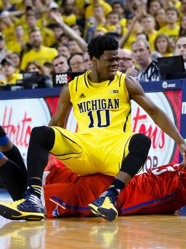 Michigan Wolverines guard Derrick Walton Jr. and Southern