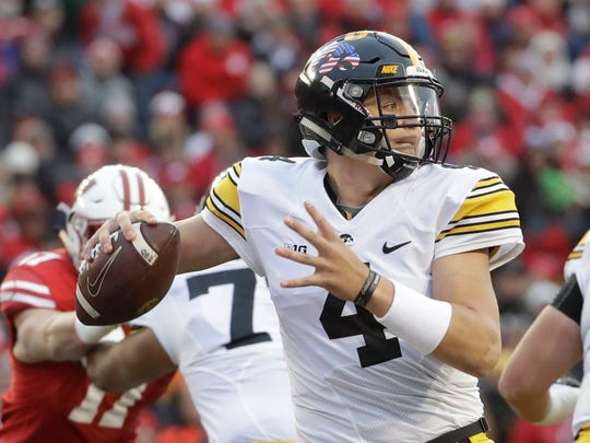Iowa quarterback Nathan Stanley throws during the first half of an NCAA college football game against Wisconsin Saturday, Nov. 11, 2017, in Madison, Wis. (AP Photo/Morry Gash)